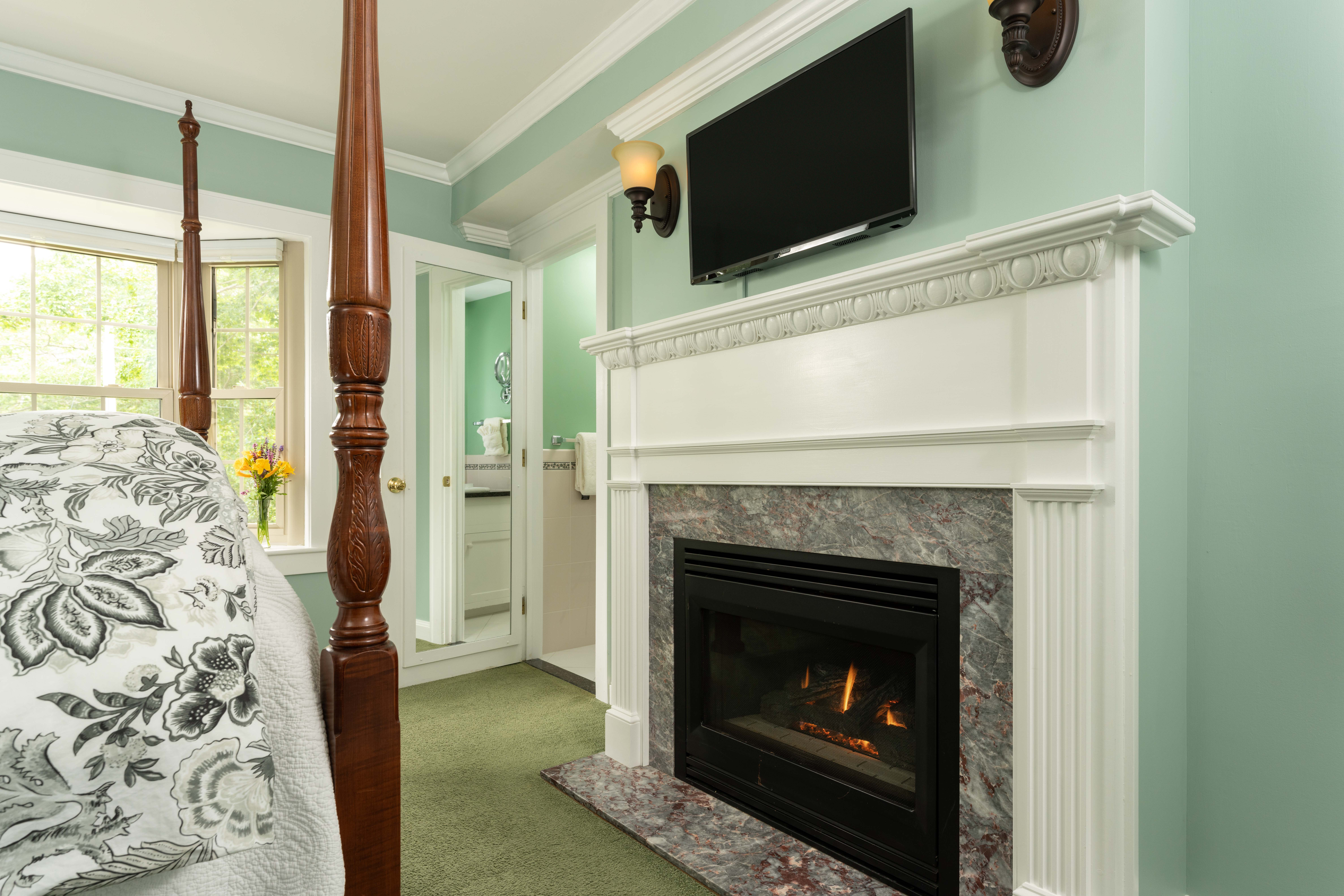 Gas fireplace framed by marble tile