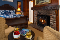 Red brick gas fireplace in a room with a queen bed