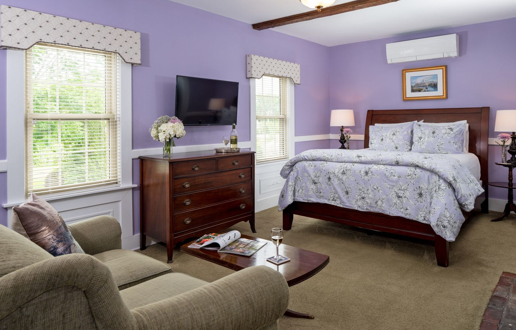 Colonial brick gas fireplace and a four poster queen bed