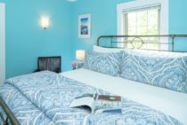 Metal bed with blue paisley duvet