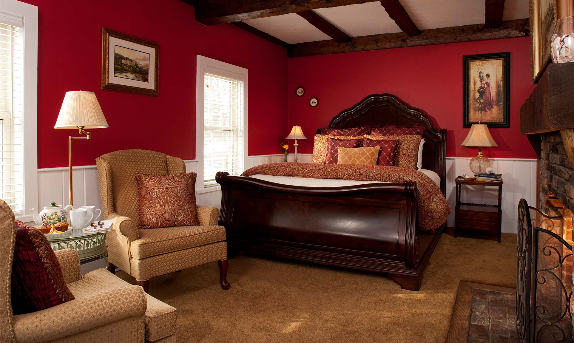Large room with a queen bed and seating area for two