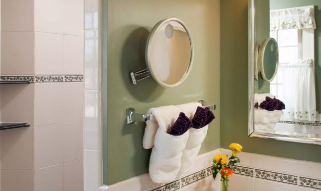 Bathroom with vanity mirror and tiled walk-in shower