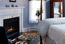 Seating area and side table in front of a gas fireplace