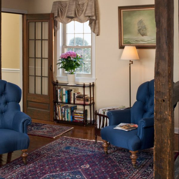 Blue chairs in the 1802 house common area