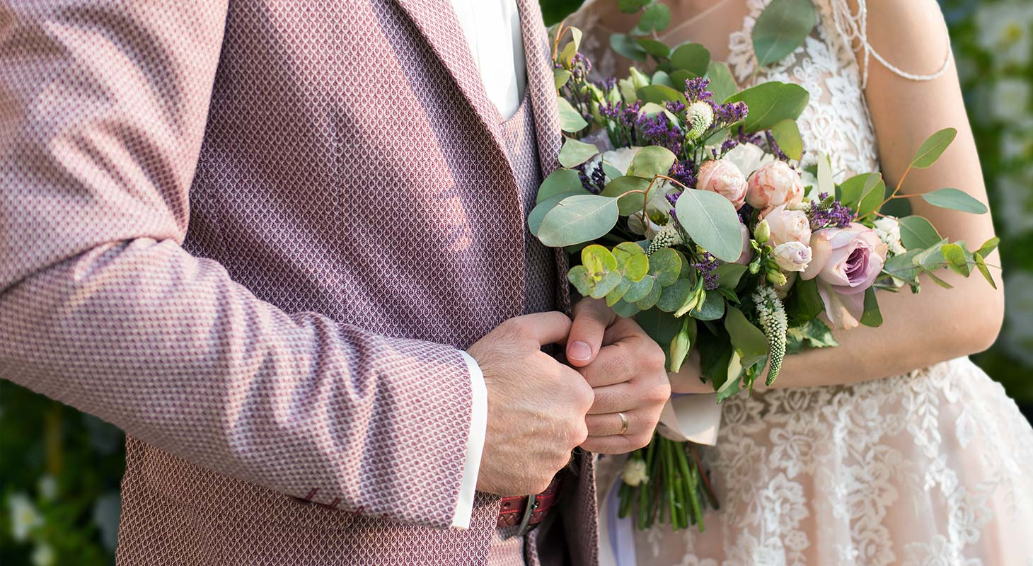 Couple holding a bouquet of flowers