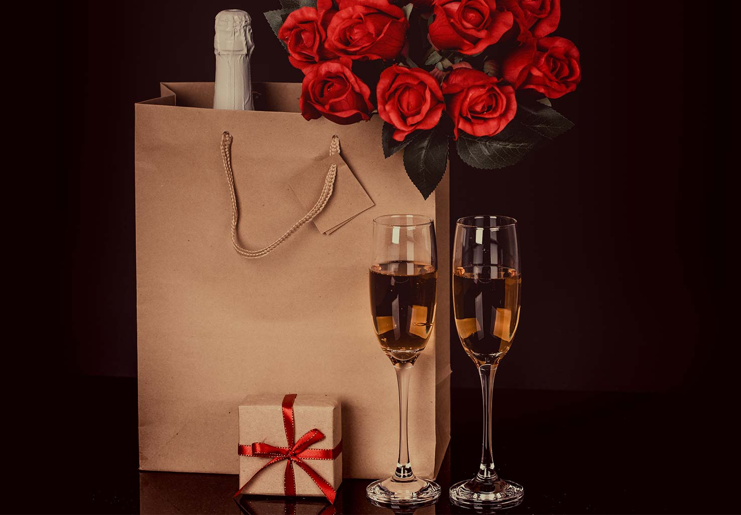 A dozen red roses, champagne and a box of chocolates
