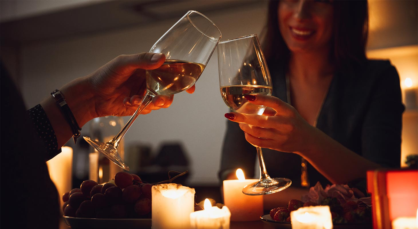 Couple toasting over a candle light dinner
