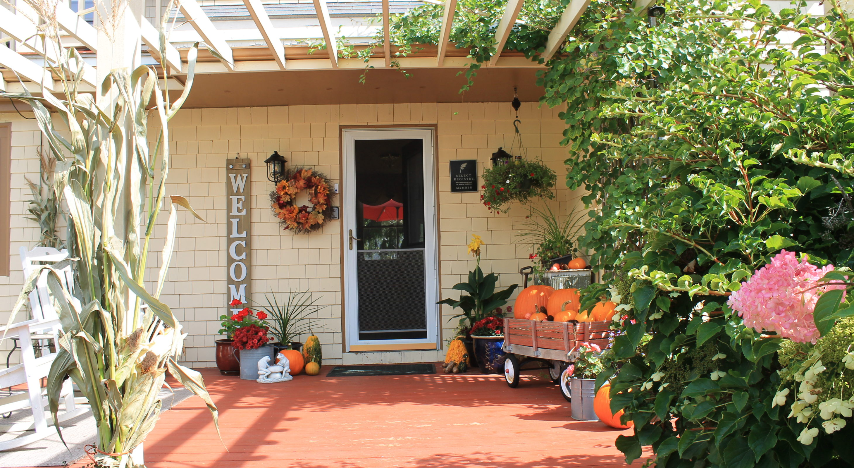 The inn's front deck decorated for fall.
