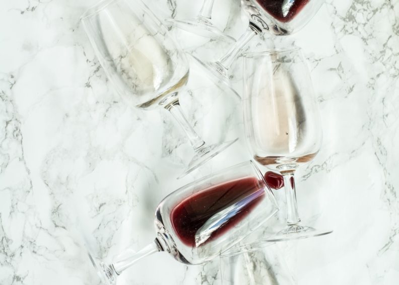 A collection of wine glasses featuring red and white wine