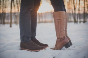 Couple's feet in snowy field