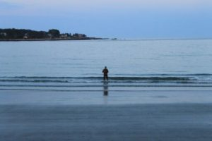 Fisherman in the ocean at day break