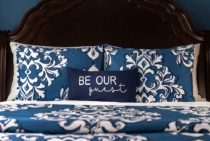 Queen bed with bright pattern and comfortable pillows