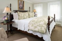Four poster bed in a well lit room