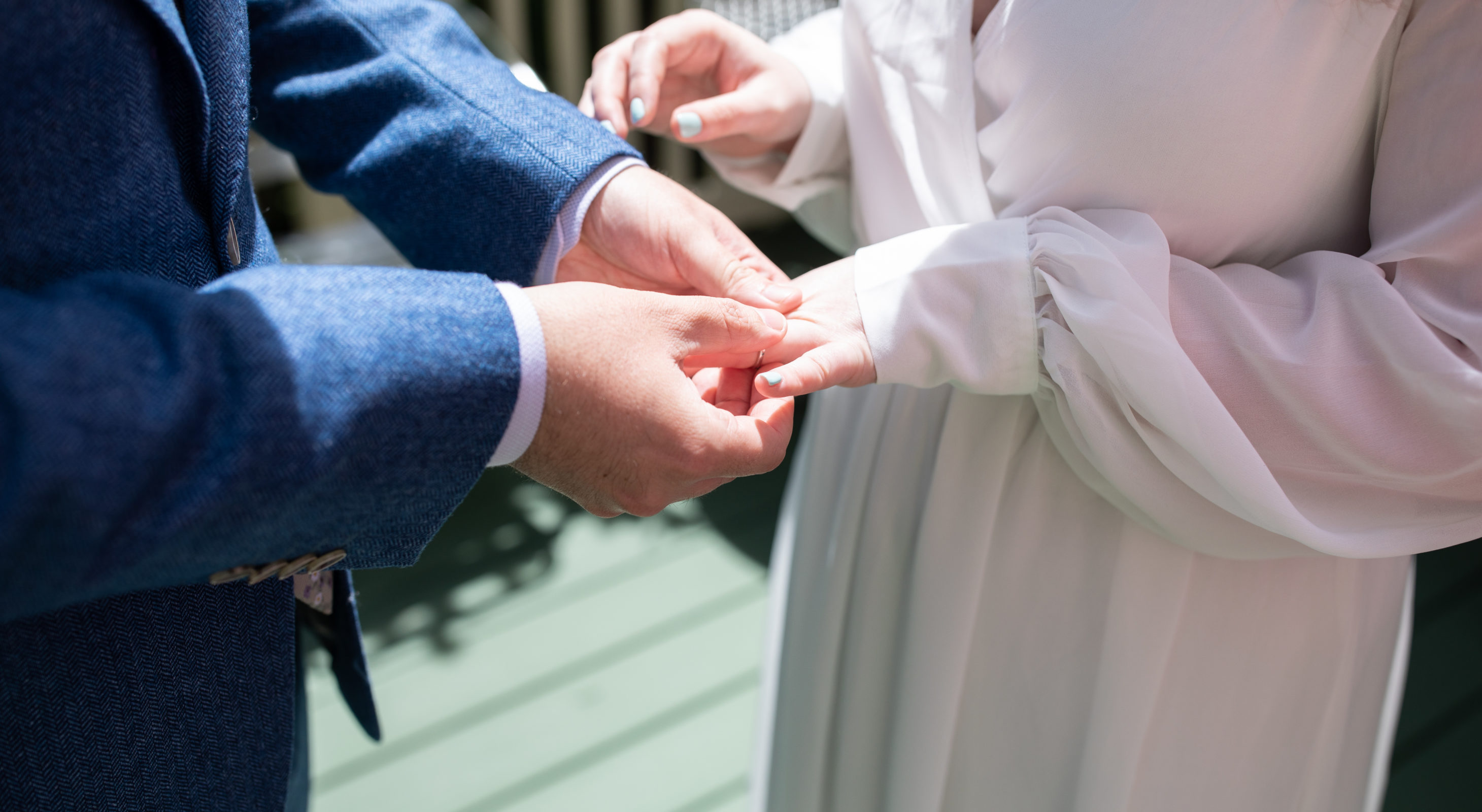 Couple exchanging rings at The 1802 House