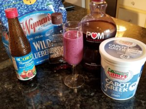 Fruit Smoothie with ingredients, agave, pomegranate molasses, wild maine blueberries and Greek Yogurt.
