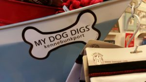 Merchandise featuring stickers and other pet items.