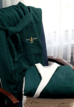 1802 house green bathrobes laid out on a chair