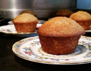 Close up of 3 pineapple muffins on china plates